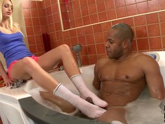 Dressed lengthy legged kirmess Erica Fontes and exposed coloured fellow have some joy in the bathroom. This chab takes a baths as that babe gives footjob near her white socks on.