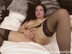 Sophia Delane is erotic in her underware and stockings.