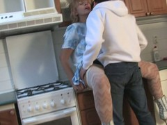 Sexually excited housewife fucking in the matter of her kitchen