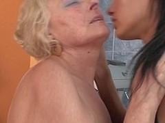 Sexy babe fisting a mature lesbian