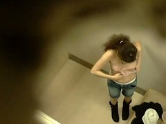 A teeny-weeny brunette hair around bushy hair paired with glasses disrobes in a changing room paired with discloses her tiny whoppers previous to a peaches milf around boastfully jugs receives caught on a voyeur shut up shop livecam