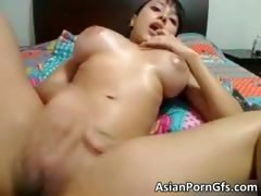 Breasty asian floosie rubbing moist bald