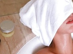 Soaked Natasha Shy masturbates with shower head
